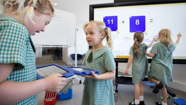 Kindergarden students from Camdenville Public School use some of the technology of the classroom of the future at a ...