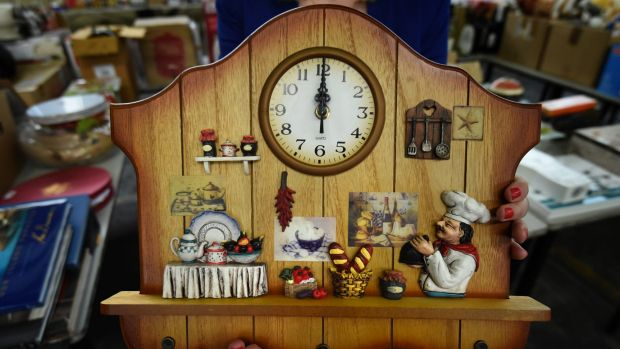 An unclaimed ornamental clock is up for auction.
