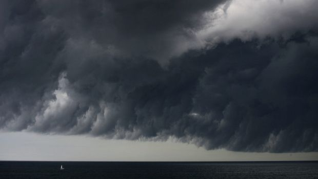A yacht is dwarfed by last week's big storm cell off Sydney.