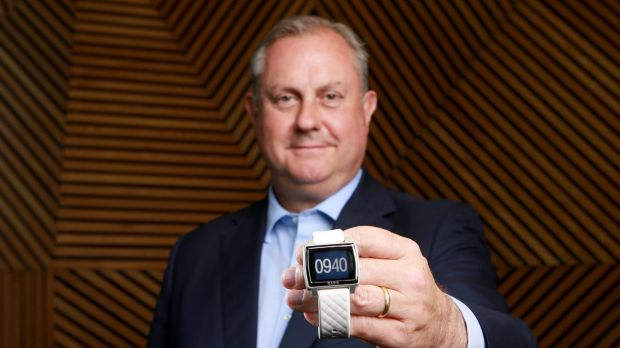 MLC executive David Hackett with the new watch that will monitor customers.