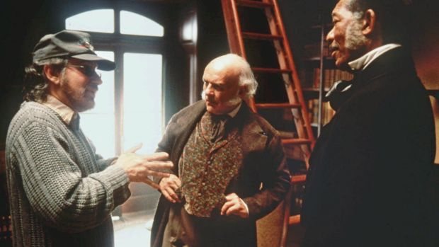 Spielberg with Anthony Hopkins, centre, and Morgan Freeman on the set of <i>Amistad</i>.