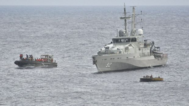 A Royal Australian Navy ship takes part in an effort to rescue suspected asylum seekers off Christmas Island in June 2012.