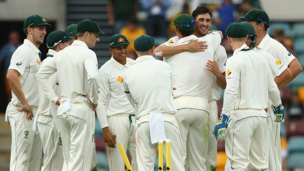 Mitch craft: Mitchell Starc embraces Mitchell Johnson after clean bowling James Neesham on day two of the first Test.