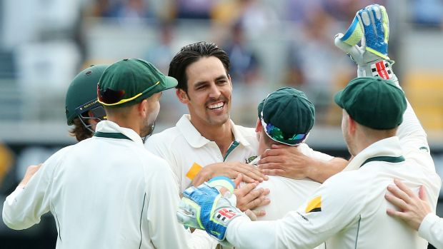 Mitchell Johnson celebrates the wicket of Ross Taylor.