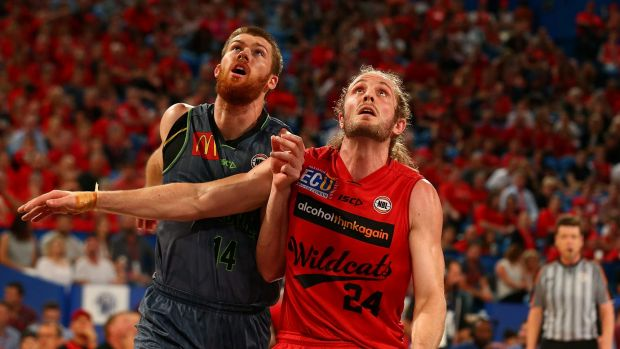 Perth Wildcat Jesse Wagstaff takes on Townsville's Brian Conklin in Perth's Friday night win