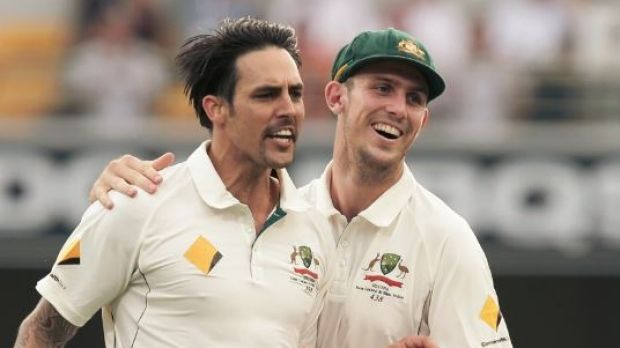 Leadership material: Mitchell Johnson celebrates with Mitchell Marsh in Brisbane.