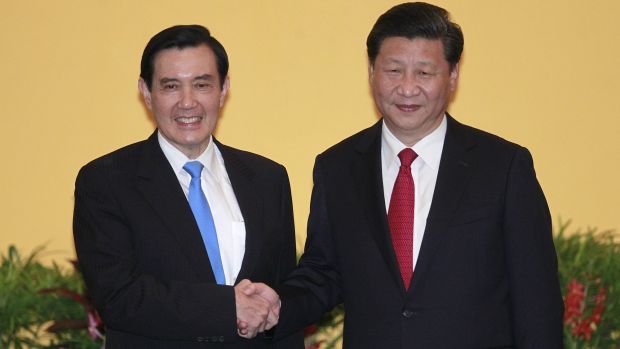 Historic meeting: Taiwan's President Ma Ying-jeou (left) and China's President Xi Jinping shake hands.