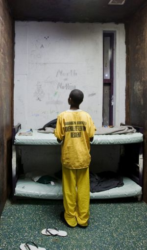 A 12-year-old juvenile in his windowless cell at Harrison County Juvenile Detention Centre in Biloxi, Mississippi.