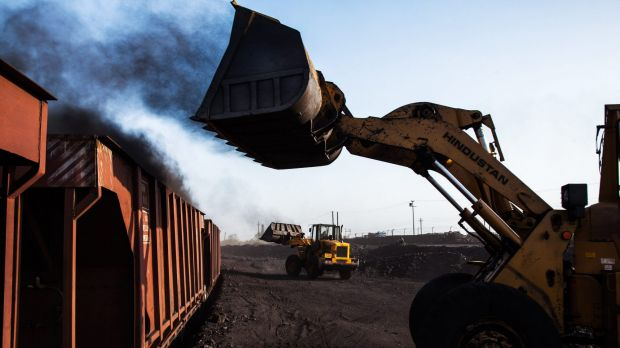 Loaders fill railcars with coal at a depot in Jharkhand, India. The longevity of the price rally will, of course, depend ...