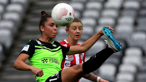 Emma Checker of Canberra contests the ball against Larissa Crummer of Melbourne City.