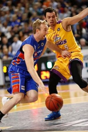 Meltdown: Adelaide guard Brendan Teys gets around Kings counterpart Jason Cadee during Sydney's capitulation at the ...