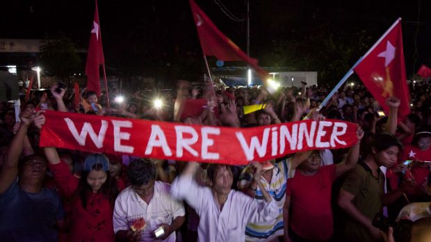 Hopeful supporters of Aung San Suu Kyi's National League for Democracy party anticipate the result of general election ...