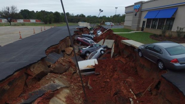 The giant sinkhole in the IHOP carpark.