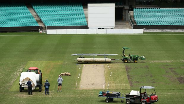 No play: Ground staff and officals announce abandonment of the NSW v Victoria match due to wet conditions during day ...