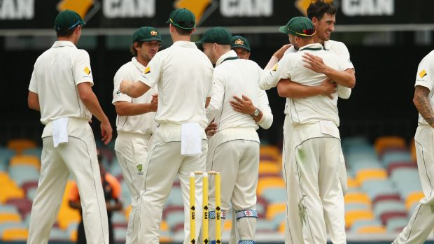 Australia celebrate  after Mitchell Starc took the wicket of Trent Boult to seal victory by 208 runs in the first Test.