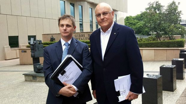 Environmental Defenders Office solicitor Sean Ryan and ACF president Peter Cousins outside the Federal Court in Brisbane ...