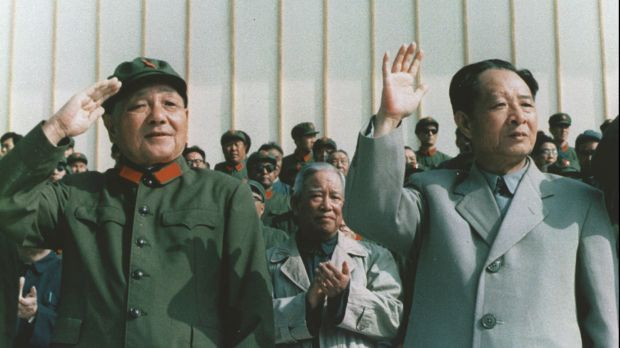Hu Yaobang, right, then secretary-general of the Chinese Communist Party, reviews a military parade with paramount ...