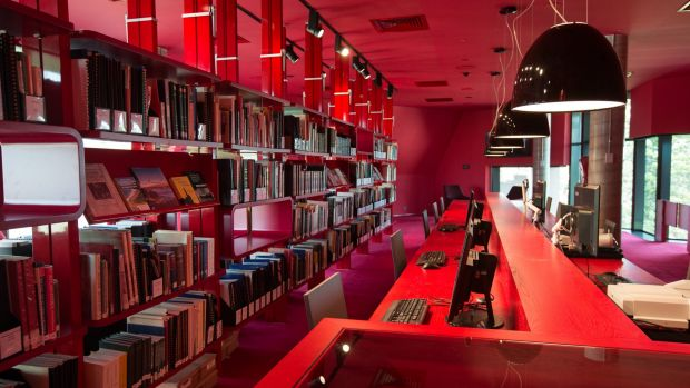 The heritage floor is decorated in bright red, with technology such as PCs, scanners and microfilm readers sitting ...