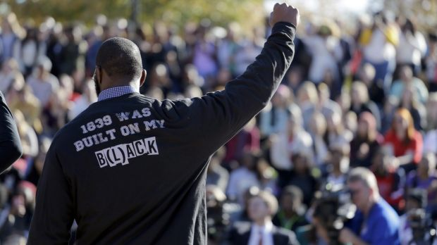 A member of the black student protest group Concerned Student 1950 gestures while addressing a crowd on Monday, ...