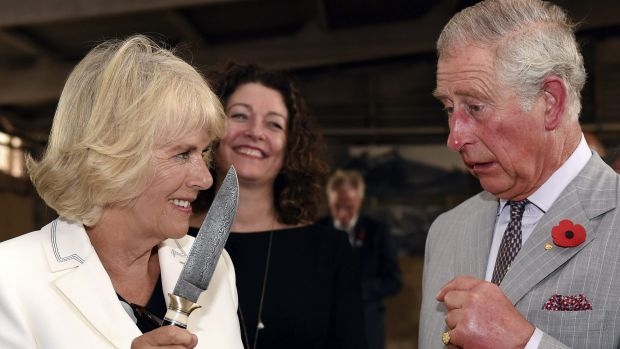 Britain's Prince Charles jokes with his wife Camilla, Duchess of Cornwall during a visit to Seppeltsfield Winery in the ...
