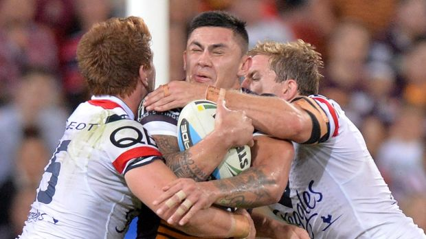 On the move: Daniel Vidot tries to crash through the Roosters defence in April.