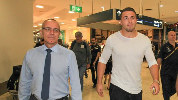 Sam Burgess arrives at Sydney Airport with South Sydney CEO John Lee.