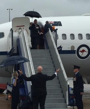 Sir Peter Cosgrove shunned an umbrella to welcome the Royals with open arms.