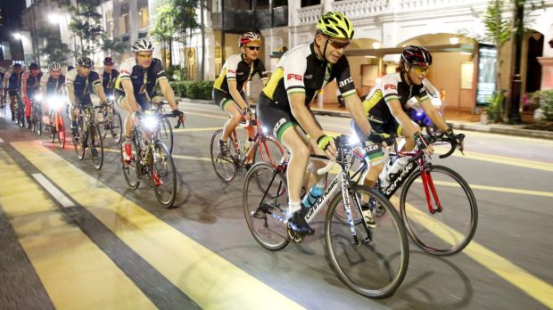 Tony Abbott with a bunch of other cyclists.