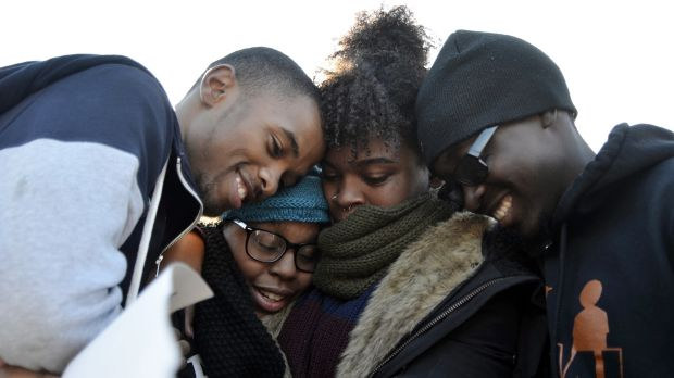 Members of Concerned Student 1950 embrace after the announcement that University of Missouri president Tim Wolfe would ...