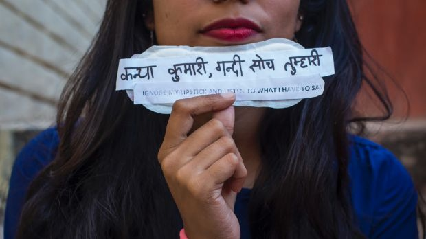 A student holds a sanitary pad with feminist messages during the viral campaign #PadsAgainstSexism by students of Jamia ...