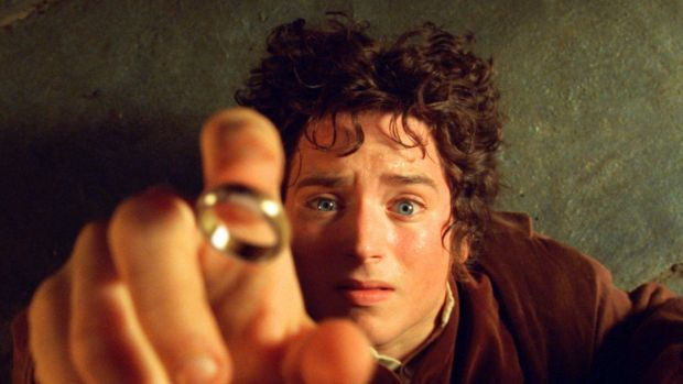"""Elijah Wood's character Frodo reaches for the """"One Ring"""", in the film the Fellowship of the Ring."""