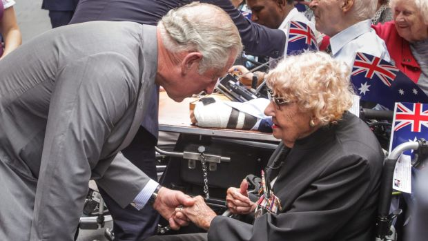 Prince Charles greets Daphne Dunne, 95, from Turramurra, in Martin Place.
