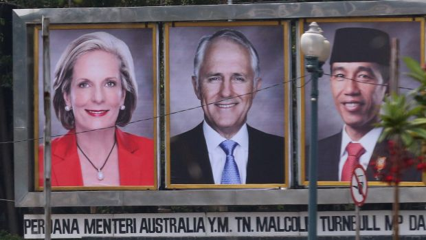 Prime Minister Malcolm Turnbull and his wife Lucy on a billboard with Indonesian President Joko Widodo near the ...