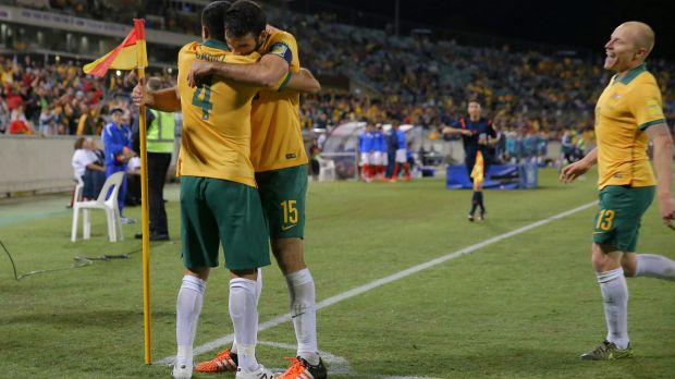 Tim Cahill is embraced by Mile Jedinak after scoring to put Australia 2-0 ahead.