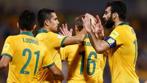 Tim Cahill and Mile Jedinak of the Socceroos high-five soon after their team was awarded a penalty.