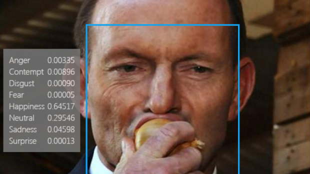 The app registered former prime minister Tony Abbott's expression as happy as he ate an onion.