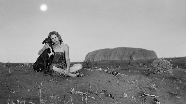 A black and white photo of Robyn Davidson at Uluru, first printed in 2014.