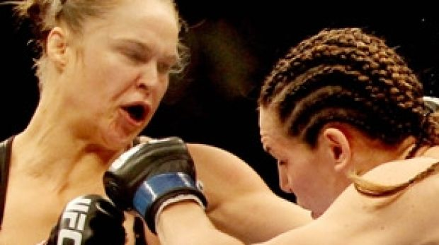 About-face: Ex-Olympic judo medallist Ronda Rousey helped change attitudes towards female UFC combatants.