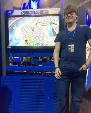 Big Paw Games' Robert Christian with <i>Rumble Academy</i> at PAX.
