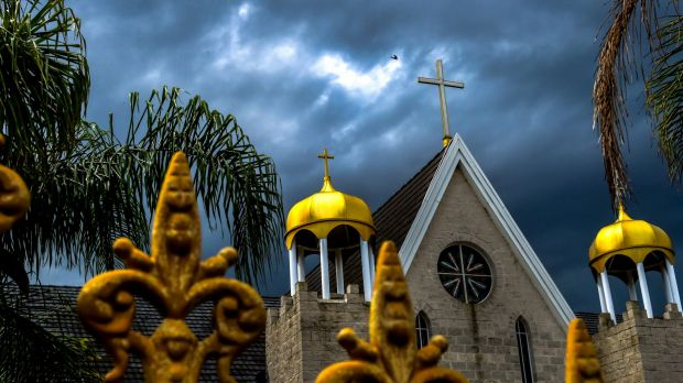 Storm clouds gather over St Zaia Cathedral, Middleton Grange in Sydney's western suburbs.
