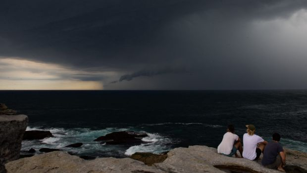 People watch the storm clouds at North Bondi on Friday.