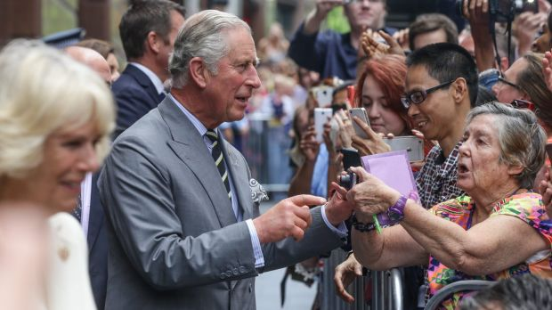 Prince Charles and Camilla meet the crowd in Sydney's Martin Place. He received many presents for his grandchildren, ...