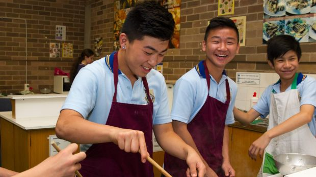 St Johns Park High School students, from left, Damien Lie, Simon Hua and Tommy Le.