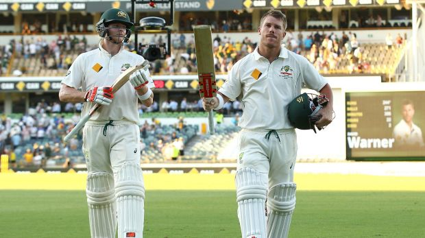 Job well done: Steve Smith and David Warner leave the field at the close of play.