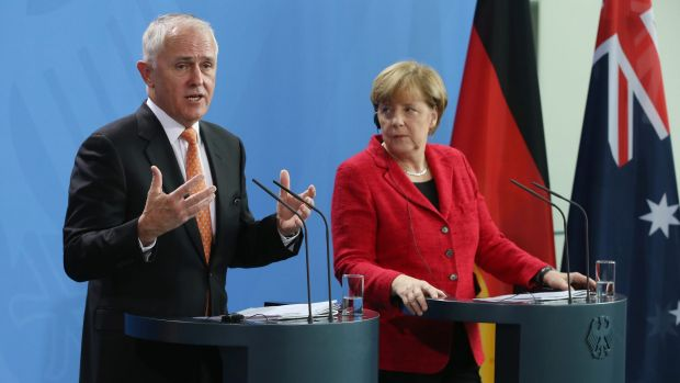 Prime Minister Malcolm Turnbull addresses the media with German Chancellor Angela Merkel following talks at the ...
