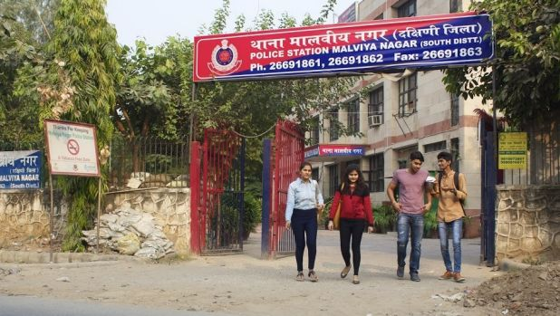 A group of young men and women leave a police station in South Delhi.
