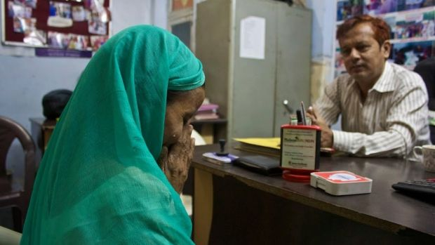 A victim speaks to counsellor Nadeem Ahmed in a women's crisis centre in north-west Delhi.
