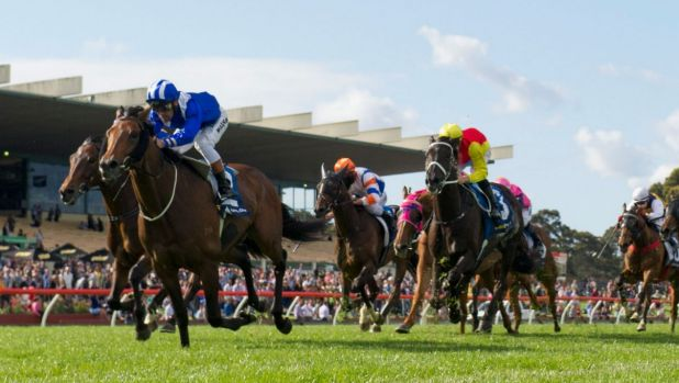 Michael Walker riding Almoonqith wins the Sandown Cup at Sandown.