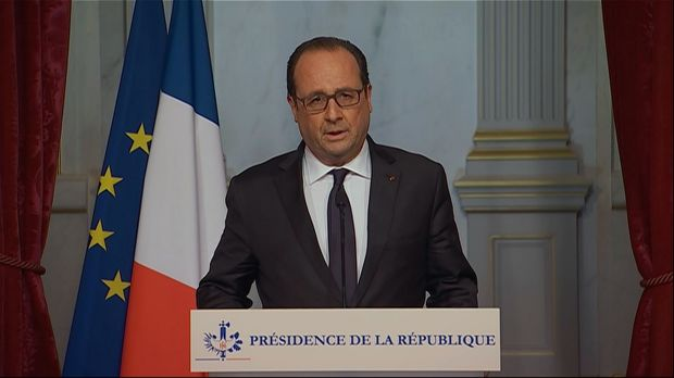 This image taken from the French television pool shows French President, Francois Hollande making an emergency broadcast ...