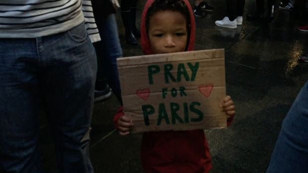 Three-year-old Gabriel holds a sign at Sydney's Martin Place vigil.